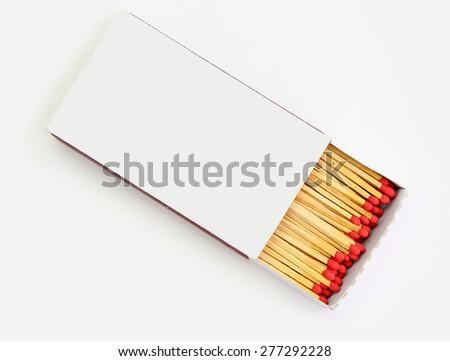 matchbox opened on white background - stock photo