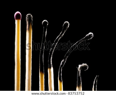 Matches on a black background. The first match the whole (all other spoiled). - stock photo