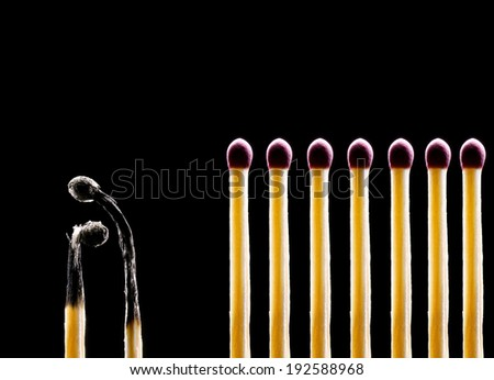 Matches on a black background. Two matches the spoiled and seven whole. - stock photo