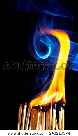 Matches with the fire and smoke. - stock photo