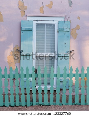 Matching green picket fence and window shutters in Santa Fe, New Mexico - stock photo