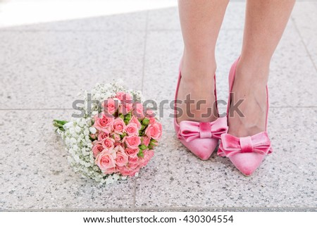 matching pink shoes with engagement bouquet