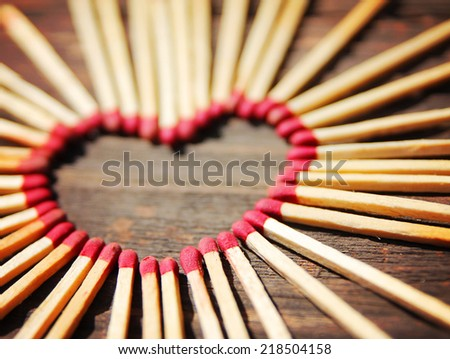 matchsticks in the shape of a heart toned with a warm filter - stock photo
