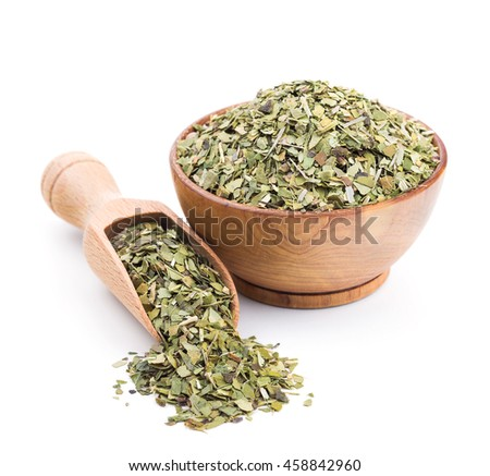Mate tea in a wooden bowl isolated on white - stock photo
