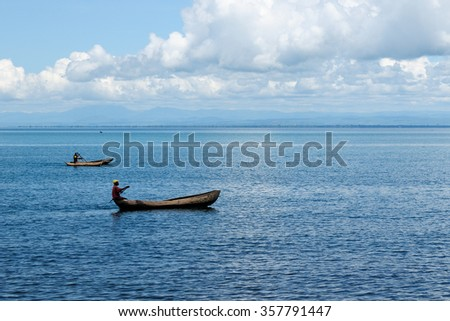 MATEMA, TANZANIA - APRIL 29: Natives from above the lake Malawi in the traditional canoe made of the one-piece tree mango in Tanzania, Matema in April 29, 2013