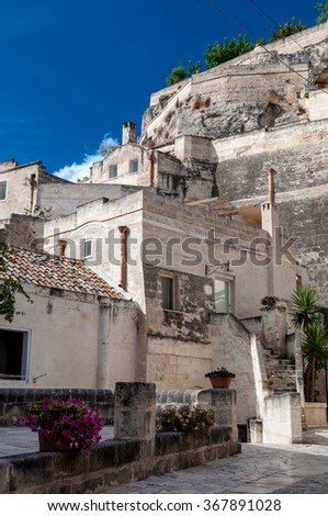 MATERA, ITALY â?? SEPTEMBER 15, 2014: Street view of Sassi di Matera ancient town. The city is a UNESCO World Heritage site and European Capital of Culture for 2019 - stock photo