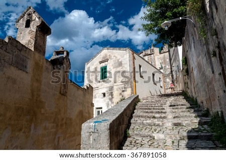 MATERA, ITALY â?? SEPTEMBER 15, 2014: Street view of stairs in ancient Sassi di Matera. The city is a UNESCO World Heritage site and European Capital of Culture for 2019 - stock photo