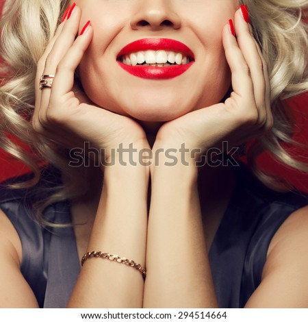Material girl and femme fatale concept. Marilyn Monroe, Madonna style. Close up portrait of rich young woman smiling wearing expensive luxurious golden ring, bracelet. Perfect shiny smile. Studio shot - stock photo