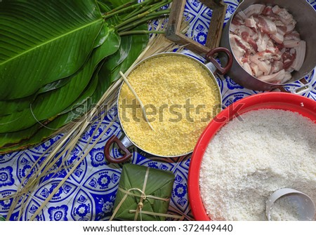 Material  including Sticky rice, pork, been, green leaf for Vietnamese food, banh chung, banh tet are traditional eating on Tet holiday, wrap in green leaf.