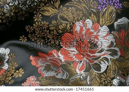 material texture - chinese satin fabric with embroidery - stock photo