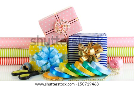 Materials and accessories for wrapping gifts with holiday gifts isolated on white