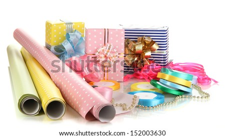 Materials and accessories for wrapping gifts with holiday gifts isolated on white - stock photo