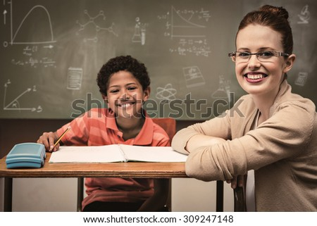 Math and science doodles against teacher assisting little boy with homework in classroom - stock photo