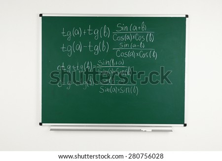 Math formulas on blackboard background - stock photo