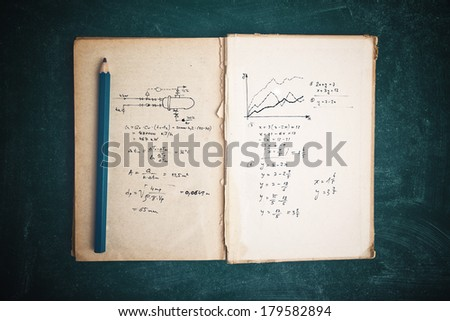 Math functions and thermodynamics calculations in old book, top view - stock photo