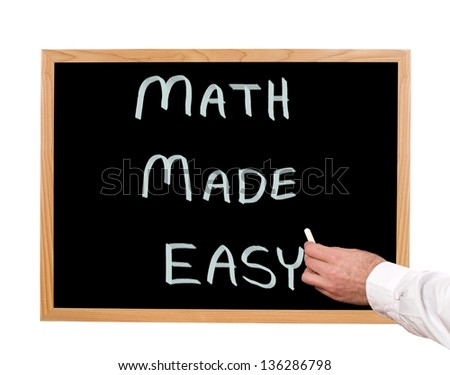 Math made easy is written in chalk on a chalkboard. - stock photo