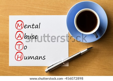 MATH - Mental Abuse To Humans - handwriting on paper with cup of coffee and pen, acronym concept - stock photo