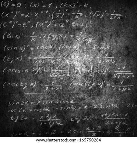 math physics formulas on grange black chalkboard - stock photo