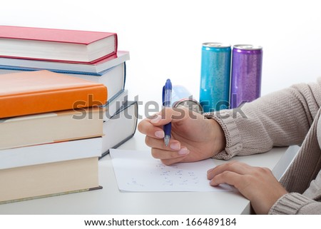 Math student solving the problems before exam - stock photo