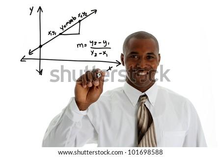 Math Teacher doing a math problem with black marker - stock photo