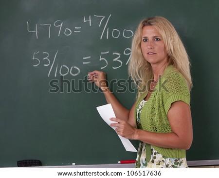 math teacher classroom chalkboard teaching fractions stock photo