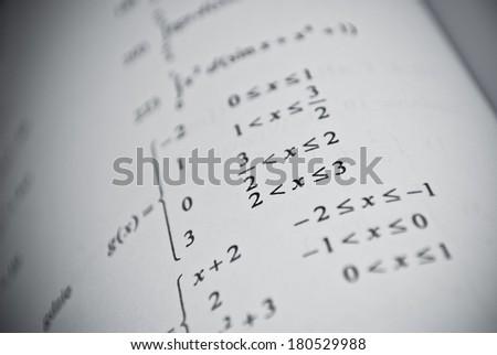 Mathematical education concept of function, integral, derivative formulas - stock photo