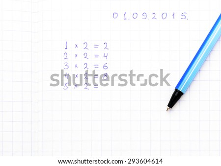 Mathematical examples are written on a sheet of paper into a cell - stock photo