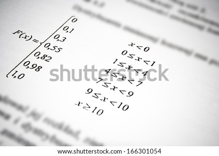 Mathematical formulas and calculations in university textbook. Math education concept.
