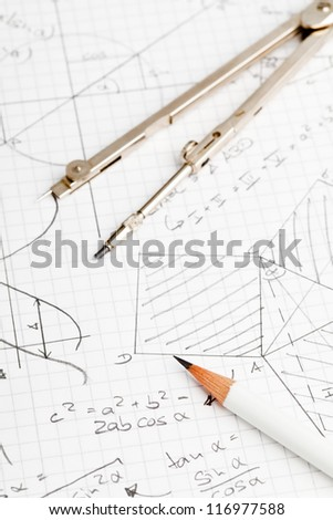 Mathematical notes about geometry and trigonometry with pencil and compass on note paper - stock photo