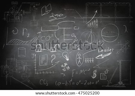 Mathematics and business icons on chalkboard