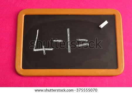 Mathematics problem written on a black board : 4 -1= ?
