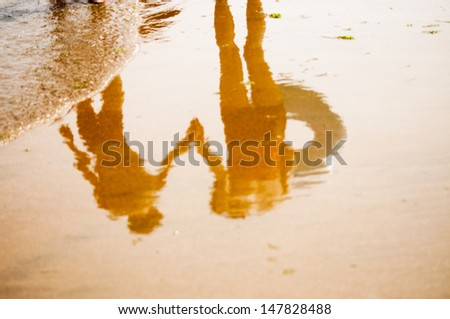 Mather and child holding hands - stock photo