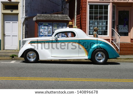 "MATHEWS, VA- JUNE 01:An old Hotrod in the Annual: Vintage TV's ""Chasing Pavement Vintage Automotive Festival"" in Mathews, Virginia on June 01, 2013 - stock photo"