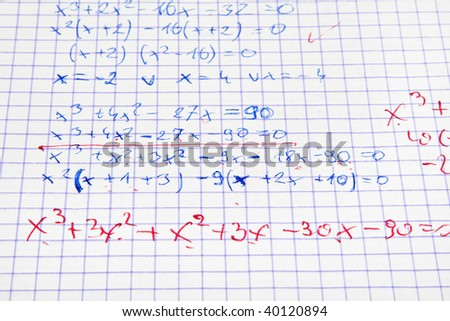 maths calculations with teacher's corrections in red