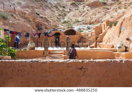 MATMATA, TUNISIA, AFRICA-CIRCA MAY, 2012: Courtyard is in rock. An underground house of cave-dweller (troglodytes) is in Tunisian village Matmata. Berbers living