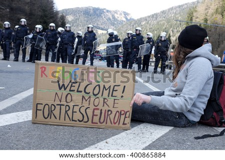 MATREI AM BRENNER, AUSTRIA - 03 APRIL 2016: The Austrian police try to control the protest against the closing of the border between Austria and Italy during the #Noborder rally held near Brennero. - stock photo
