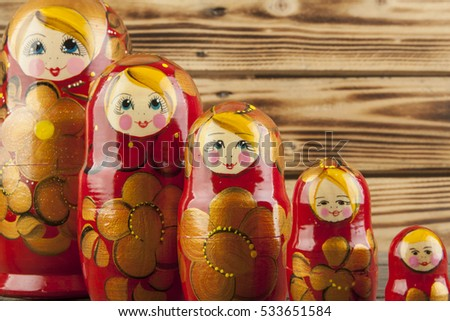 Matrioshka or babushkas dolls on a wooden background