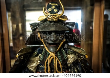 MATSUE/JAPAN - MAY 21, 2014: Samurai traditional war helmet and armor in the museum of Matsue castle in Matsue, Shimane prefecture, Japan