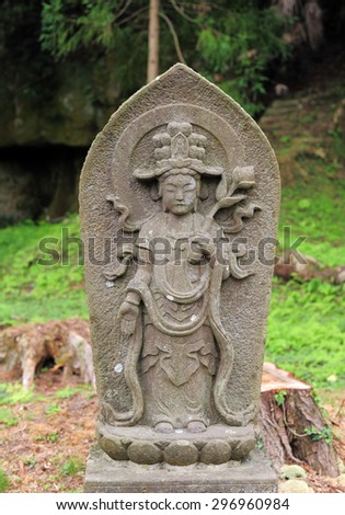 MATSUSHIMA, JAPAN - JULY 8, 2015 : Buddhist statue located along the entrance to the Zuiganji Temple in Matsushima. The area is considered one of the Three Most Scenic Spots in Miyagi District , Japan - stock photo