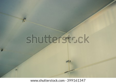 Matte glass wall and ceiling in perspective view. Modern futuristic interior.