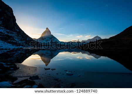 Matterhorn and Dente Blanche from Riffelsee mountain lake above Zermatt, Switzerland