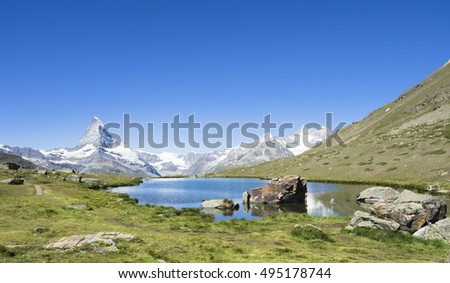 Matterhorn and Stellisee in the summer day, Switzerland