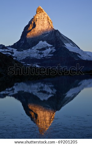 Matterhorn at dawn reflected in the Riffelsee - stock photo