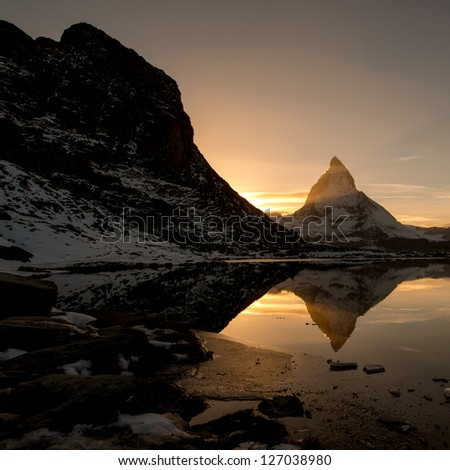 Matterhorn from Riffelsee mountain lake above Zermatt, Switzerland