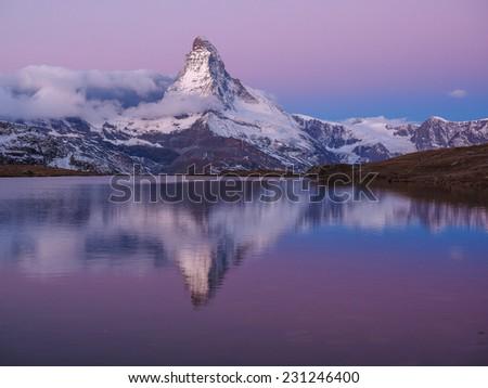 Matterhorn in early morning with relfection in StelliSee, Zermatt, Switzerland - stock photo