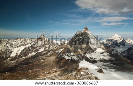 Matterhorn in swiss alps and other high peaks with snow