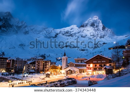 Matterhorn (Monte Cervino) mountain in moonlit blue evening. Cervina ski resort in the Alps, Valle'd Aosta, Italy