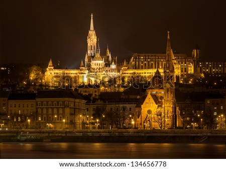Matthias Church and Protestant church in Budapest at night - stock photo