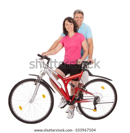 Mature active couple doing sports. Isolated on white - stock photo