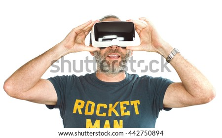 Mature adult man wearing virtual reality VR glasses / googles. His livingroom transforms into VR space. isolated on white